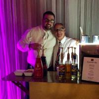 Groom Bryan and Espresso Dave bonding at the wedding reception