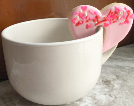 Love on a mug! Your coffee loving guests will adore these red hot cookie toppers with a Valentine's Day coffee bar. Click here to read about Boston's Espresso Dave's Coffee Catering suggestions to serve with a coffee bar. www.espressodave.com Cookie Toppers by The Baker's Rack. #ValentinesDay #Valentines #coffeebar #Boston #valentinesdaytreats #galentines #galentinesday